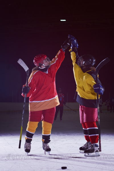 teen girls ice hockey players portrait