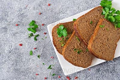 Pieces of rye bread on a plate. Top view