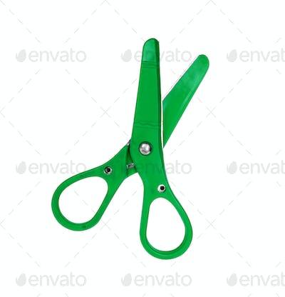 Green scissor isolated on white