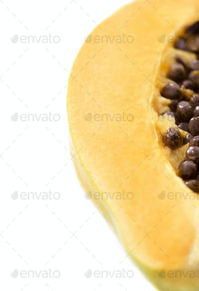 Papaya fruit sliced on white