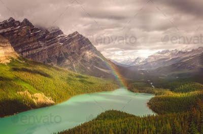Snecin view of Peyto lake and Rocky mountains with rainbow