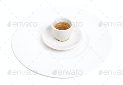 Espresso cup on a plate.