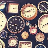 Closeup of various clocks isolated on black