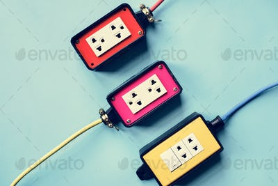 Electrics power supply plugs on blue background