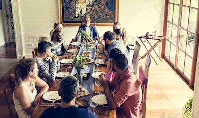 Group of diverse friends are having a dinner together