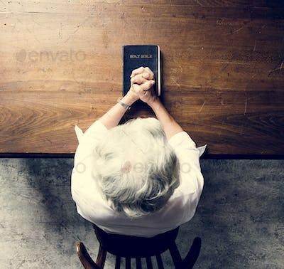 Senior woman prayer faith in christianity religion