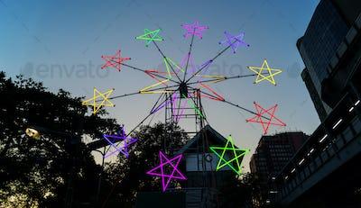 Star shaped neon windmill in a festival