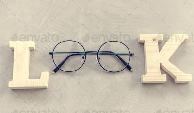 Look word with eyeglasses flatlay aerial view