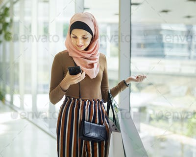 Islamic woman looking on the phone