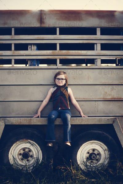 A young girl is having fun in the farm