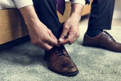A man tying shoe lace