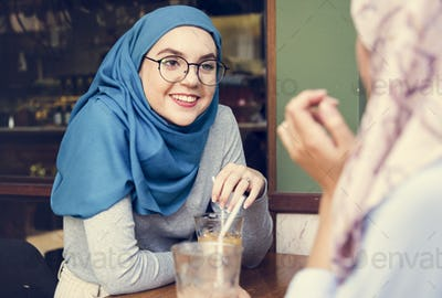 Islamic women friends enjoying and talking in the coffee shop