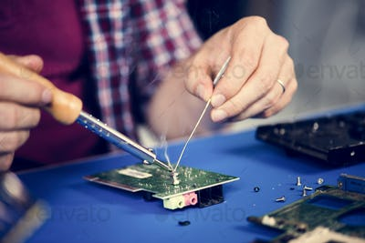 Closeup of tin soldering with electronics circuit board