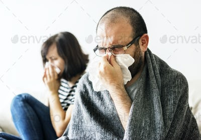 Couple sick together at home