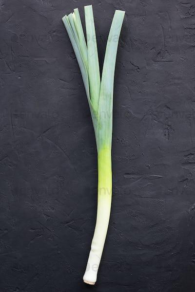 Fresh organic leek on black background