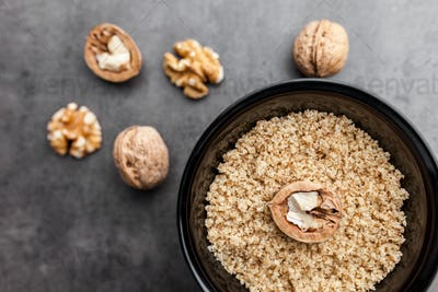 Delicious walnuts on rustic background