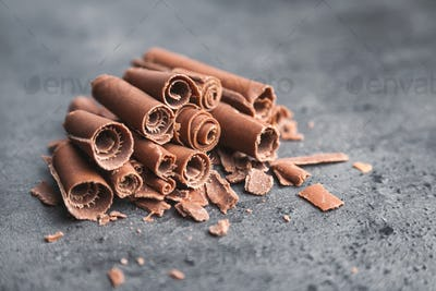 Delicious chocolate swilrs on rustic background