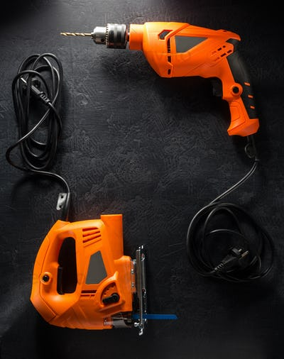 electric tools with cord on black