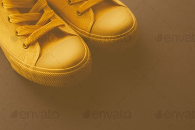 Brand new yellow sneakers on the floor