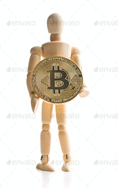 Bitcoin currency and wooden puppet.