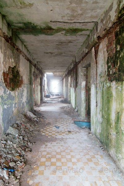 Long corridor in an abandoned and desolate building