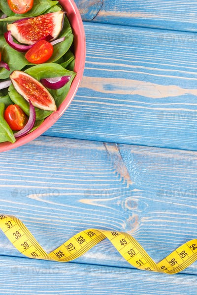 Fruit and vegetable salad and centimeter, slimming and nutrition concept