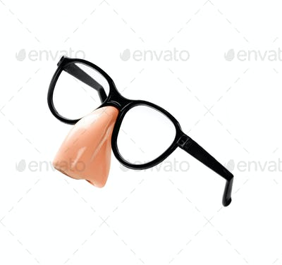 Funny disguise glasses and nose isolated