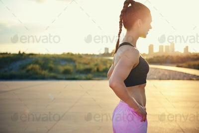 Side view of woman pausing after a workout