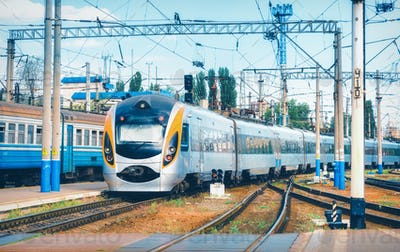 High speed train arrives on the railway station