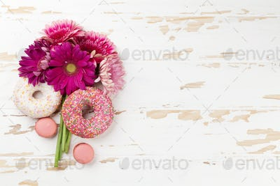 Donuts and gerbera flowers bouquet