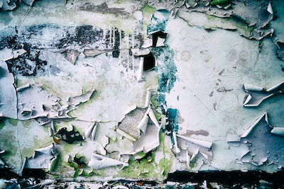 Wall with peeling paint, grunge background.