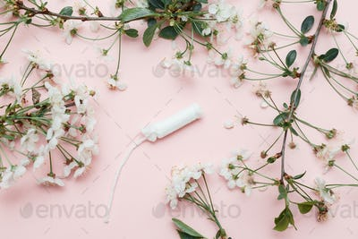 Hygienic tampon and sanitary napkin for every day with pink and white blossom