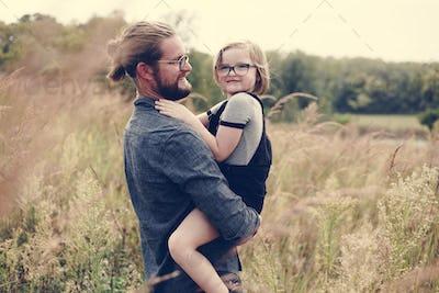 Caucasian dad having fun with daughter