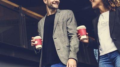Couple having take away coffee together