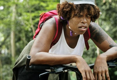 Tired female cyclist in the forest