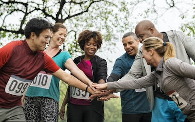 Team of diverse people ready for a race