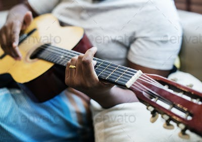 Man playing on his guitar