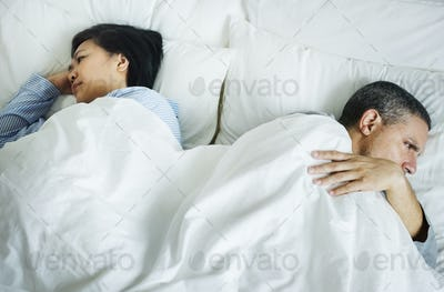 Couple on a bed having a problem