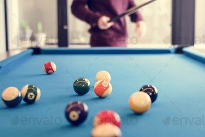 Billiard balls on a pool table