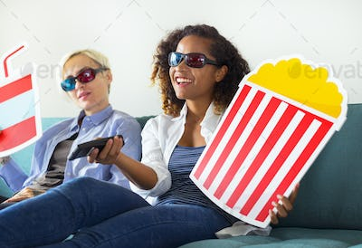 Young women watching three dimensional movie