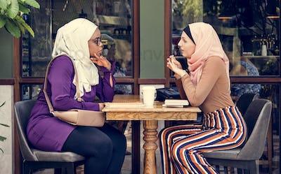 Islamic women friends enjoying and talking in the coffee shop