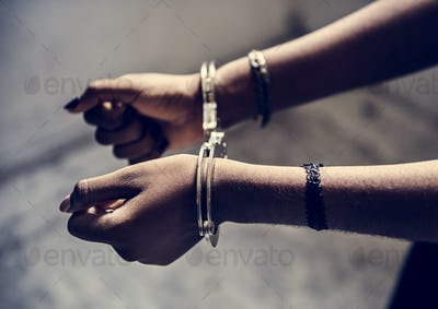 Closeup of arrested hands with handcuffs