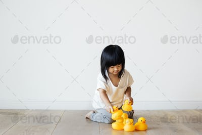 Young Asian girl playing alone