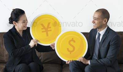 Business people with currency icons