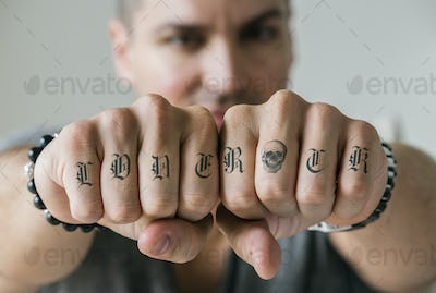 Closeup of knucle tattoos of a man