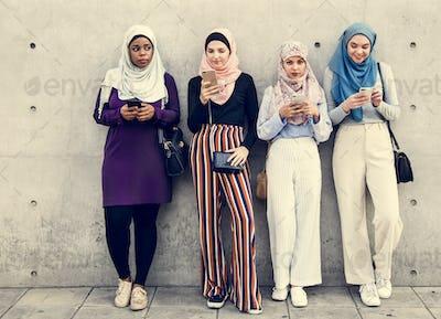 Group of islamic girls using smart phone