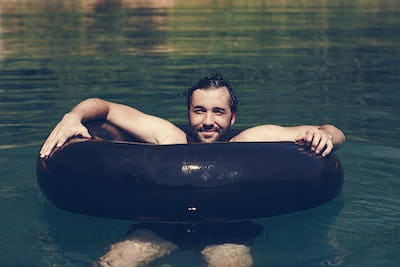 Happy man floating around in the water