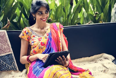 Indian woman using digital tablet