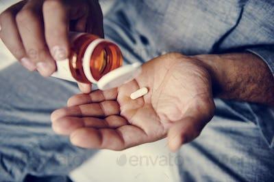 Man taking medicaation