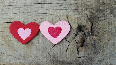 Two hearts on wooden